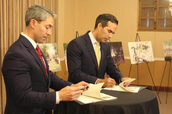 San Antonio Mayor Ron Nirenberg and Texas Land Commissioner George P. Bush sign a resolution in support of a master plan for a redesign of Alamo Plaza.