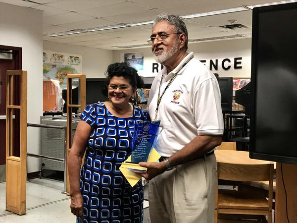 Boodnaraine Tihal, right, poses with his wife after the Broward Teacher's Union honored him with a plaque at Seminole Middle School Tuesday.