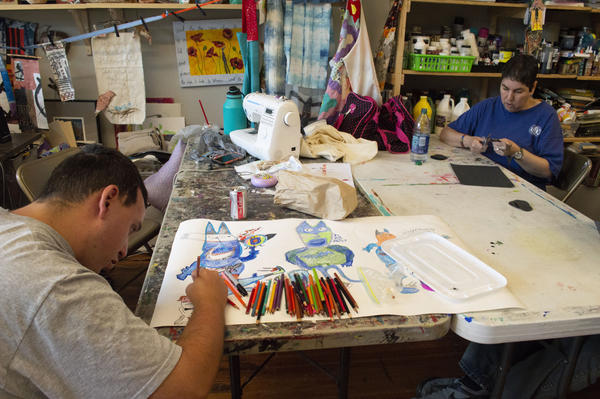 Michael Wiedle and Pauline McDonald work on their latest art projects.