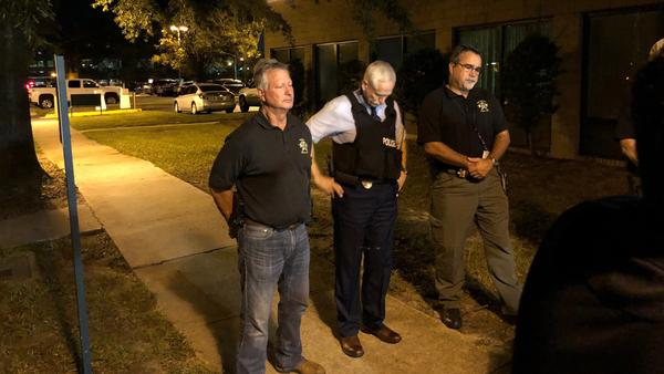 (From left) Florence County, S.C., Sheriff Kenney Boone, Florence Police Chief Allen Heidler and Florence County Chief Deputy Glenn Kirby speak to reporters about the shootings of law enforcement officers on Wednesday.