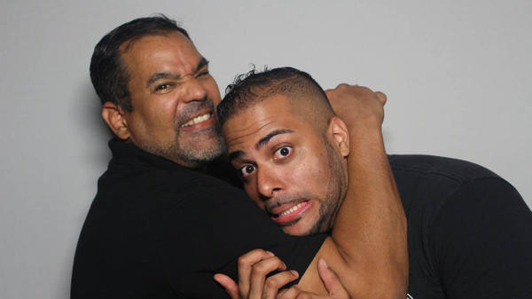 Abraham Guzman (left) puts John Torres Jr. in a friendly chokehold at the StoryCorps booth in New York City.