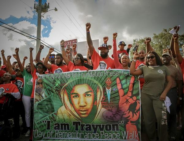 Sybrina Fulton (center), Tracy Martin and many more take part in Trayvon Martin's Peace Walk in Miami Gardens, FL on February 10, 2018.