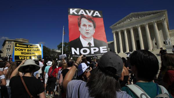 Demonstrators gather Thursday outside the Supreme Court, demanding that the Senate reject Judge Brett Kavanaugh's nomination.