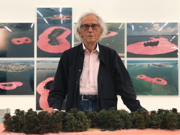 "Bulgarian artist Christo stands in front of the exhibition honoring his artistic project ""Surrounded Islands"" at the Perez Art Museum."