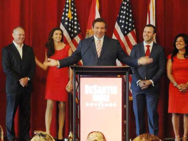 Ron DeSantis is joined on stage by Florida House Speaker Richard Corcoran, far left, and his wife Casey to his left. Rep. Chris Sprowls and Rep. Jackie Toledo are to his right