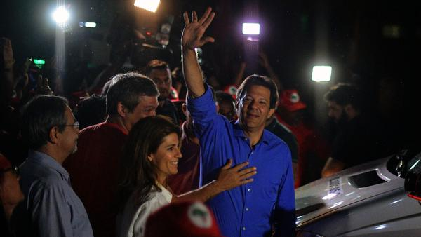 Brazil's presidential candidate for the leftist Workers' Party, Fernando Haddad, waves during a campaign rally in Rio de Janeiro on Monday.