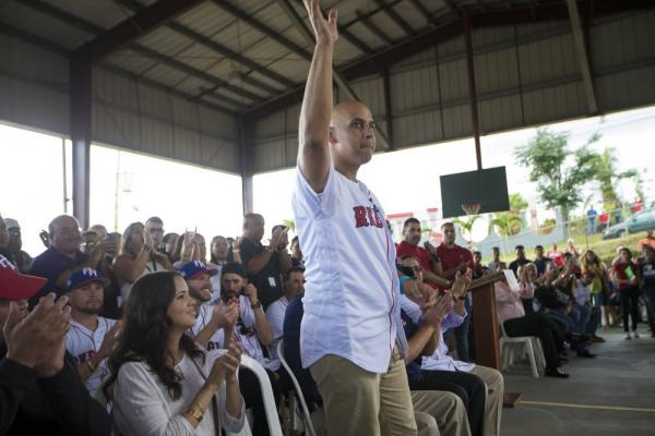 During a relief trip in early 2018, Red Sox manager Alex Cora gets a hometown hero's welcome at La Mesa Sports Complex in Caguas. (Jesse Costa/WBUR)