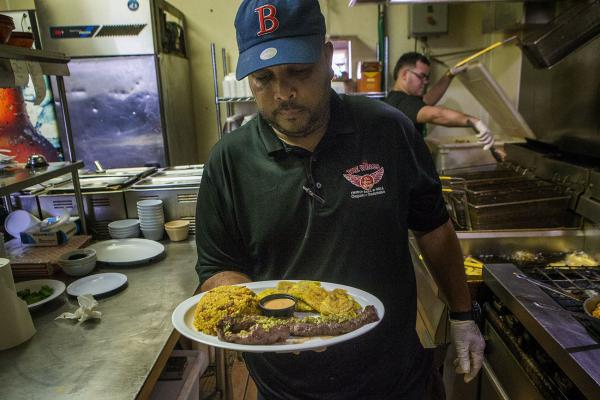 Cora's favorite dish at The Wings in his hometown of Caguas: skirt steak with rice and beans. (Jesse Costa/WBUR)
