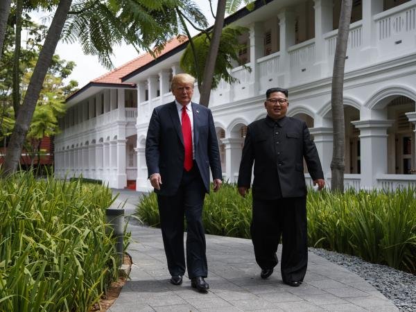 President Donald Trump walks with North Korean leader Kim Jong Un in Singapore in June.