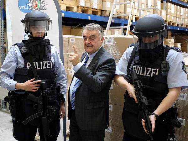 North Rhine-Westphalia's interior minister Herbert Reul, seen with police officers, apologized for mistakes that left a Syrian man falsely imprisoned and then dead when a fire broke out in the jail.