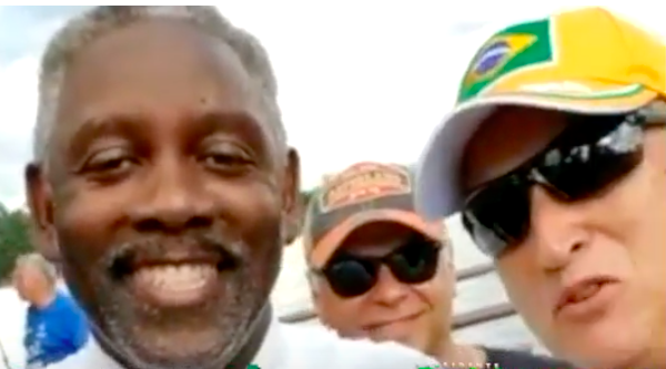 Orange County Sheriff and Mayor-elect Jerry Demings (left) at a rally in Orlando last week for controversial Brazilian presidential candidate Jair Bolsonaro, posing with expat Bolsonaro supporters.