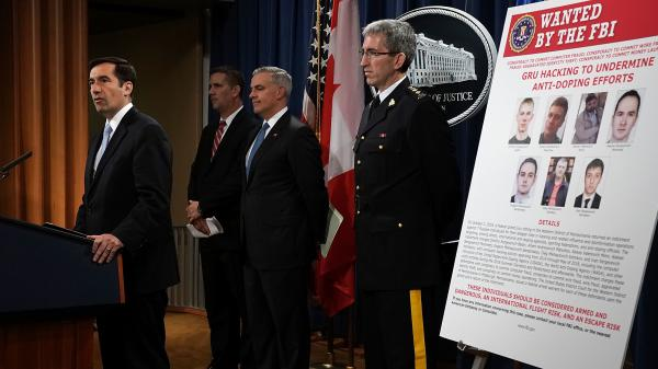Assistant U.S. Attorney General for National Security John C. Demers, left, speaks as U.S. Attorney for the Western District of Pennsylvania Scott W. Brady, 3rd from left, FBI Deputy Assistant Director for Cyber Division Eric Welling, 2nd from left, and Director General Mark Flynn, right, for the Royal Canadian Mounted Police listen during a news conference to announce criminal charges Thursday.