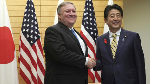 U.S. Secretary of State Mike Pompeo shakes hands with Japanese Prime Minister Shinzo Abe in Tokyo on Saturday. The two met before Pompeo's planned Sunday meeting with North Korean leader Kim Jong Un.