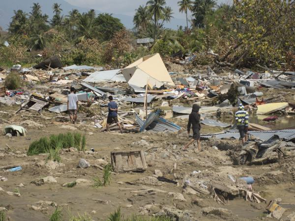 In the obliterated area of Petobo in Palu city, houses and trees were flattened and entire sections of the neighborhood born along on a sea of mud in a phenomenon known as liquefaction.