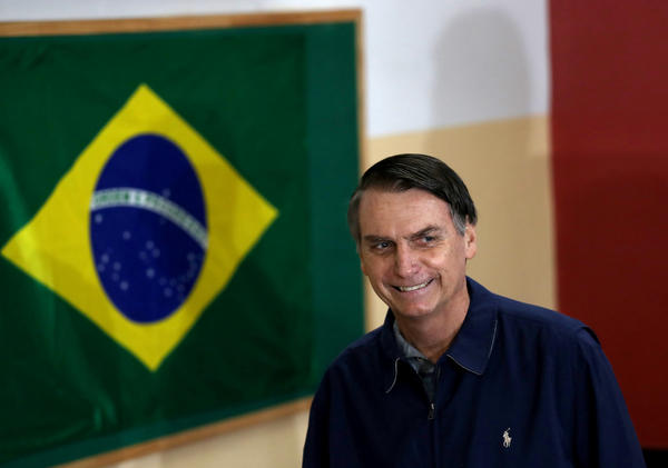 Jair Bolsonaro, far-right lawmaker and presidential candidate of Brazil's Social Liberal Party, arrives to cast his vote in Rio de Janeiro on Sunday.