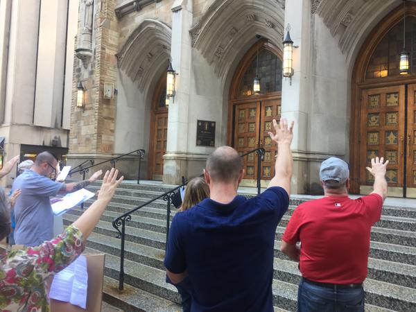About a dozen people held a vigil on the front steps of the cathedral. Organizers say they're encouraged by the Diocese of Cleveland releasing the names of priests who were removed from their posts due to sex abuse allegations.