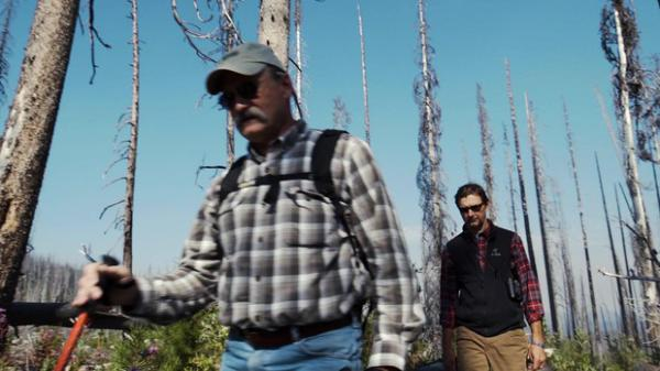 <p>Ecologists Paul Hessburg (left) and Bill Gaines search for woodpeckers on Freezout Ridge on the side of Tiffany Mountain.</p>