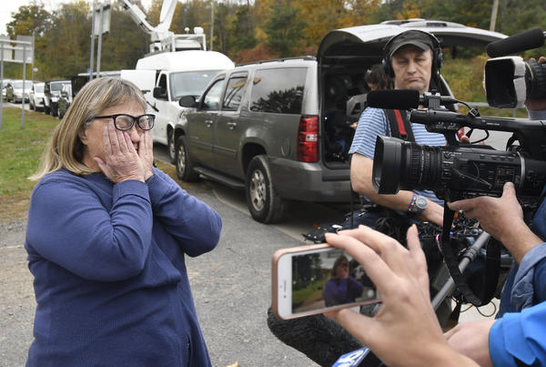 Barbara Douglas of Danamora, N.Y., reacts while talking about her four family members who died in Saturday's fatal crash in Schoharie, N.Y., on Sunday.