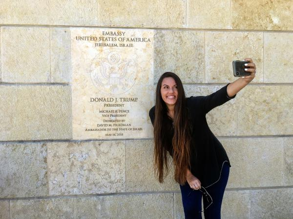 Beckah Shae, a Nashville-based singer-songwriter popular on Christian radio, snapped selfies with the dedication plaque outside the U.S. Embassy to Israel in Jerusalem.