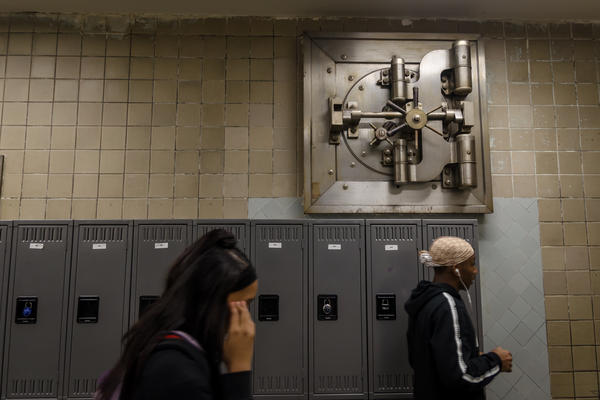 Students walk down a hallway of Lift for Life Academy, which includes an old bank vault door. The charter school opened in the former Manufacturer's Bank and Trust Company building in Kosciusko, an industrial neighbhood on St. Louis' south side,  in 2000.