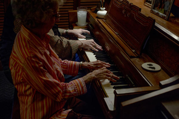 Richard Langford, 64, and his mother Leta Langford, 89, play the piano together at their home in East Nashville. Richard almost died a decade ago and still still suffers some cognitive symptoms, but says music keeps him going.
