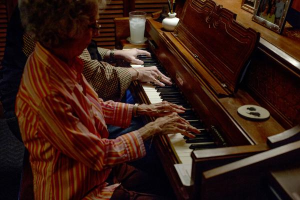 Richard Langford and his mother Leta Langford, play the piano together at their home in East Nashville. Richard almost died a decade ago and still suffers some cognitive symptoms, but he says music keeps him going.