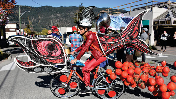 Costumed activists riding elaborately decorated bicycles paraded down the streets of Vancouver last month to bring attention to the challenges facing the sockeye salmon population in the Fraser River and its connection to Canada's indigenous people.