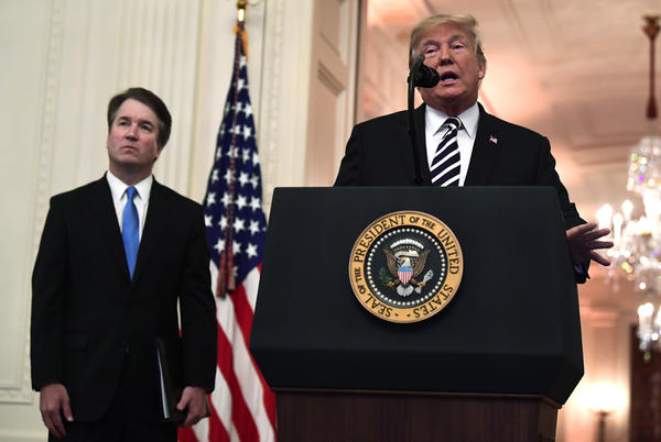 President Donald Trump with Supreme Court Justice Brett Kavanaugh, speaks before a ceremonial swearing-in in the East Room of the White House in Washington, Monday, Oct. 8, 2018.