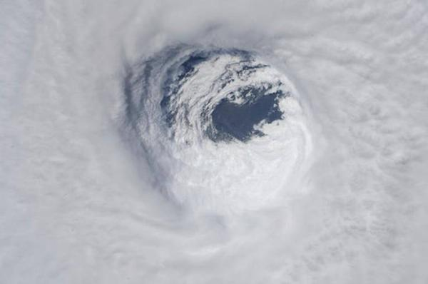 This photo made available by NASA shows the eye of Hurricane Michael as seen from the International Space Station on Wednesday, Oct. 10, 2018.
