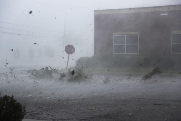Debris blows down a Panama City street on Wednesday during the storm. The hurricane was one of the most powerful ever to strike the U.S. mainland.
