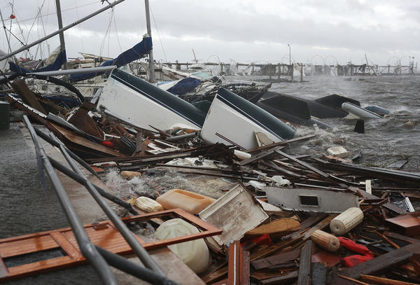 Boats that were docked are seen in a pile of rubble after hurricane Michael passed through the downtown area on October 10, 2018 in Panama City, Florida.