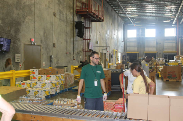 Second Harvest Food Bank volunteers pack boxes for Hurricane Michael.