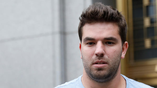 Billy McFarland, seen outside the courthouse in July, has been sentenced to six years in prison and three years on probation; he also will have to pay restitution of just more than $26 million.