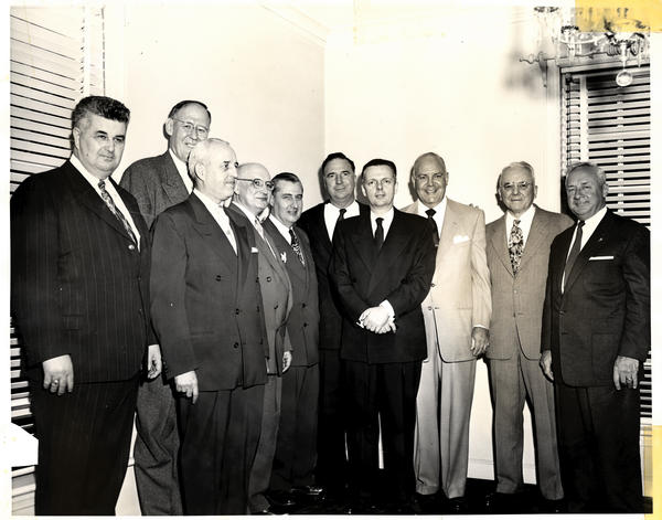 "Orville Hodge, center, stands among top Illinois politicians. Among them, to Hodge's immediate right, is Illinois Governor William ""Bill"" Stratton, who served from 1953 to 1961."