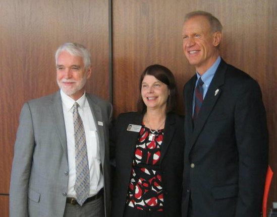 University of Illinois President Tim Killeen (left), Northern Illinois University President Lisa Freeman (center), and Illinois Governor Bruce Rauner (right)