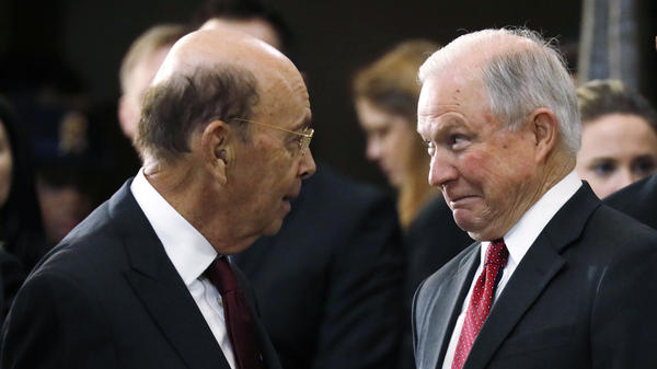 Commerce Secretary Wilbur Ross (left) talks to U.S. Attorney General Jeff Sessions before the start of a ceremony in February in Washington, D.C. The two Trump administration officials spoke about adding a citizenship question to the 2020 census in the spring of 2017, according to a new court filing.