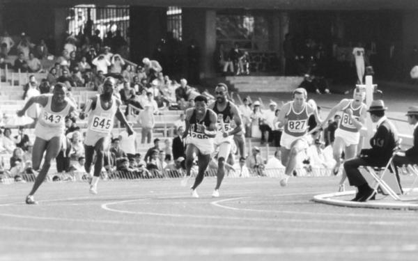 Melvin Pender receives the hand-off in the 4 x 100 meter relay during the 1968 Olympics, for which he won a gold medal.