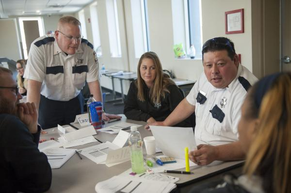 Illinois Department of Corrections officers participate in a role-playing exercise during a March training session on working with female inmates, at Logan Correctional Center in Lincoln, Ill.