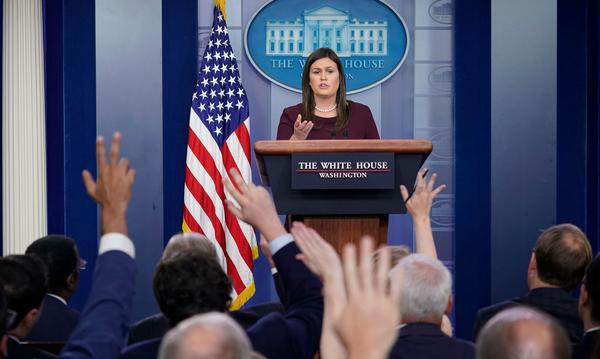 White House press secretary Sarah Huckabee Sanders speaks during a briefing in the White House on Aug. 14.