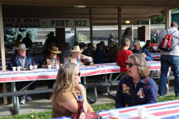 <p>People have breakfast at a VFW fundraiser before the Pendleton Roundup and Rodeo gets underway.</p>