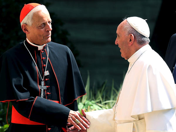 Pope Francis has accepted the resignation of the Archbishop of Washington, Cardinal Donald Wuerl. The two are seen here during the pope's visit to Washington, D.C., in 2015.