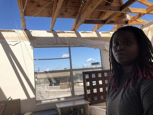 Anjaleesa Douglas can now see daylight from her bedroom. Only two pieces of plywood are still attached to the roof truss.