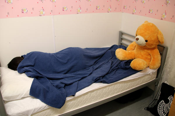 A 12-year-old Iranian refugee girl, who had tried to set herself on fire with petrol, rests in a bed in Nauru, where nearly 1,000 refugees and asylum seekers have been sent by the government of Australia.