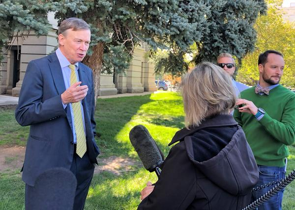 Colorado Gov. John Hickenlooper takes questions from reporters Friday, Oct. 12, at the State Capitol.