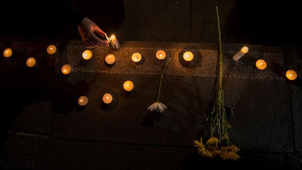 Chilean demonstrators light candles during an August vigil in Santiago that protested the sex abuse scandal roiling the Catholic Church.