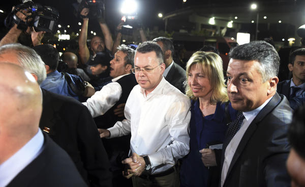 Pastor Andrew Brunson (center) arrives at the airport Friday night in Izmir, Turkey, with his wife, Norine.
