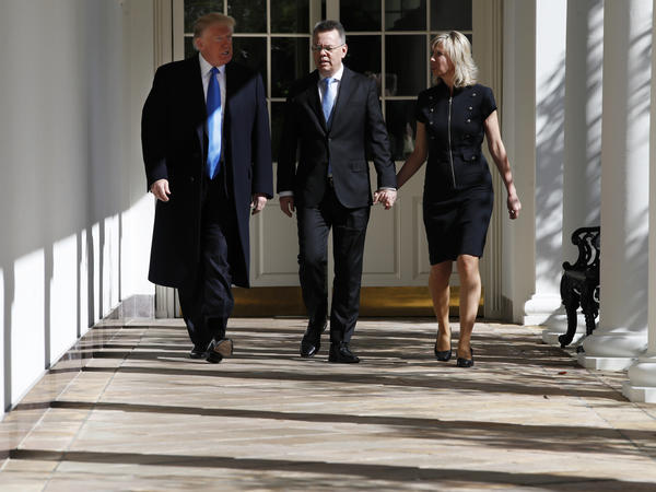 Andrew Brunson walks down the colonnade of the White House on Saturday, flanked by his wife, Norine, and President Trump.