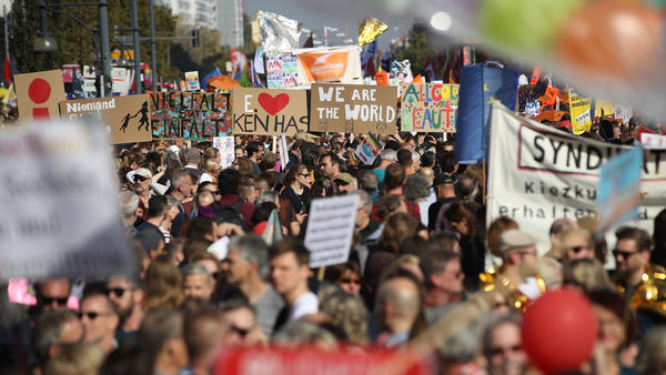 Demonstrators march Saturday in a massive protest against racism in Berlin.