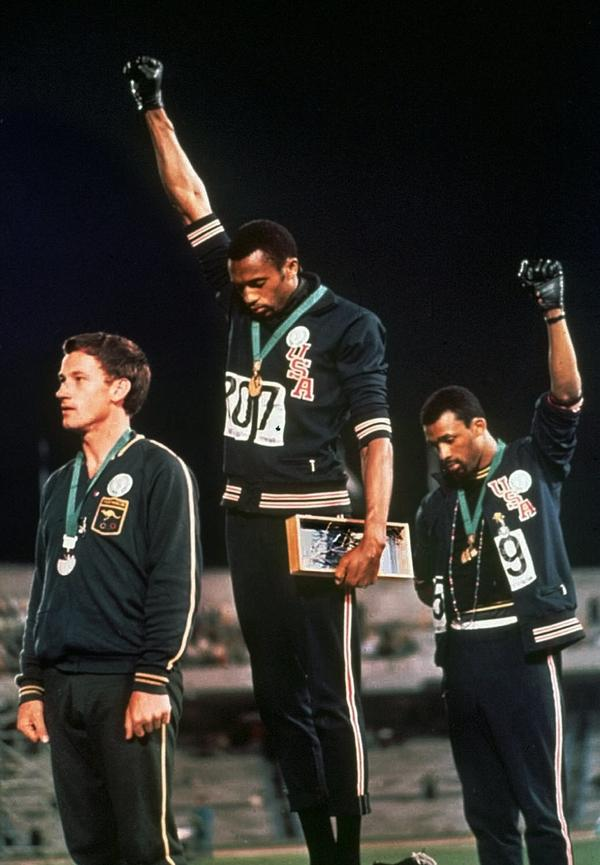 "Extending gloved hands skyward in racial protest, U.S. athletes Smith and Carlos stare downward during the playing of ""The Star-Spangled Banner"" at the Summer Olympic Games in Mexico City on Oct. 16, 1968."