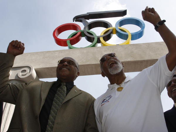 Smith (left) and Carlos hold up their fists at the Mexican Olympic Committee building in Mexico City on Oct. 15, 2008.